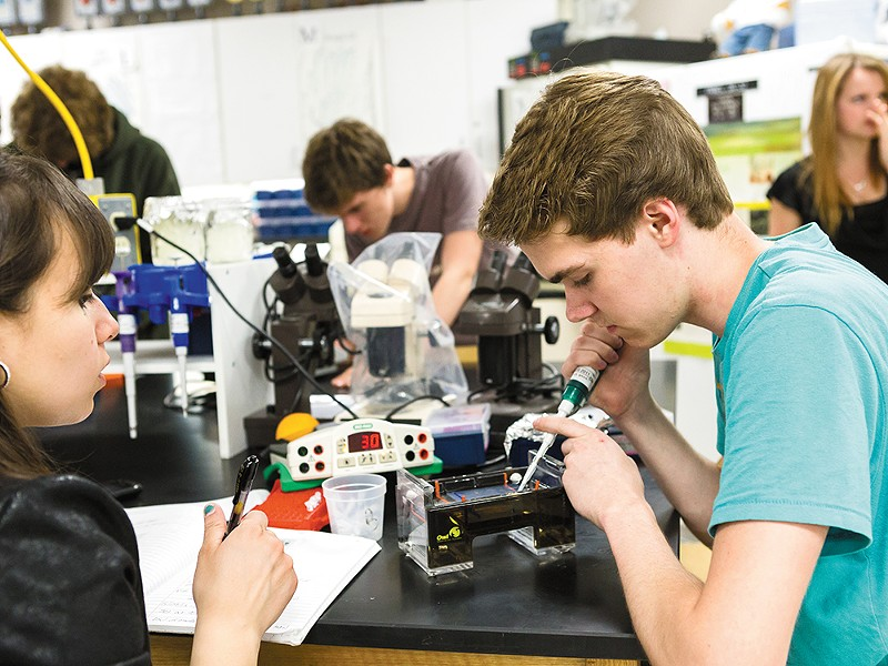 Reyna Lomeli (left) and Tanner Streicher in the science lab at North Central High School. - STEPHEN SCHLANGE