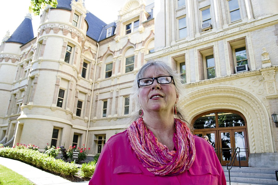 Rhoda Behrens, in front of the Spokane County Courthouse, has encountered many legal obstacles to obtaining mental health treatment for her 26-year-old son, Richie Hoisington. - JACOB JONES