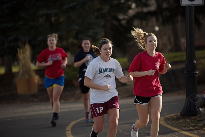 (Right to left) Gonzaga students 19 year old sophomore Emily Kleier, 20 year old freshman Ashley Taylor, 21 year old junior Carissa Thomas and 21 year old senior Amanda Minter jog down a path. - YOUNG KWAK