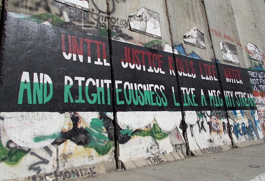 Graffiti on the separation wall in the West Bank links the civil rights movement and Palestinians' current struggle for equality. - TAYLOR WEECH