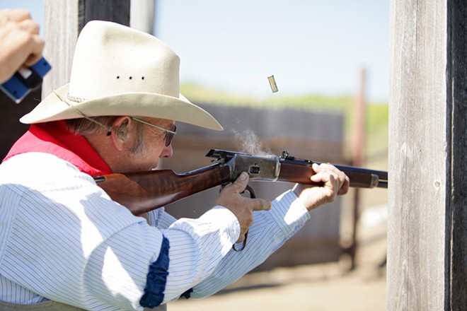 """Roger """"Hop Along Hoot"""" Sherman fires his Hartford 92 rifle during a Windy Plains Drifters match in Medical Lake on July 13. - YOUNG KWAK"""