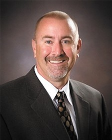 Roger Quarles, deputy superintendent of the Idaho Department of Education, says Schoolnet is working much better now — but he'll have to convince local districts.