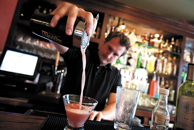 Ryan Roberge makes a Maker's Mark Manhattan. - MIKE MCCALL