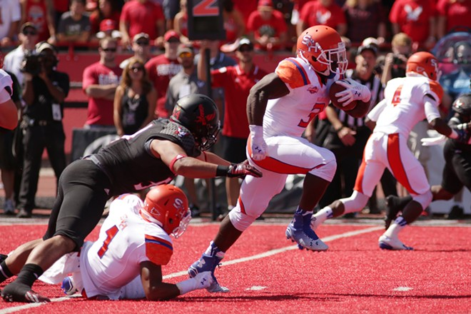 Sam Houston State running back Keshawn Hill, center, runs the ball during the first half. - YOUNG KWAK