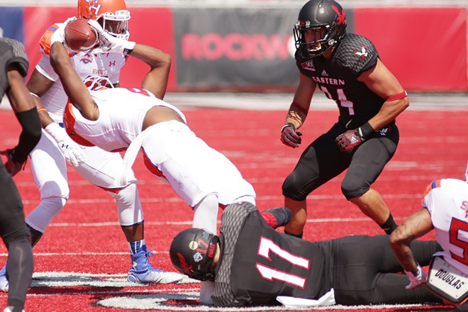 Sam Houston State wide receiver Yedidiah Louis, left, is brought down by Eastern Washington defensive back Jake Hoffman (17) during the first half. - YOUNG KWAK