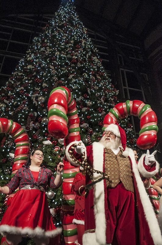 Santa dances with his elves. - SARAH WURTZ