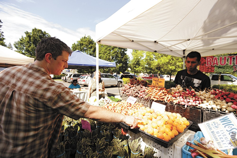 Santé Chef and Owner Jeremy Hansen (this year's winner of Best Chef) shops at the South Perry Farmers Market. - YOUNG KWAK