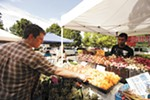 Santé Chef and Owner Jeremy Hansen (this year's winner of Best Chef) shops at the South Perry Farmers Market.