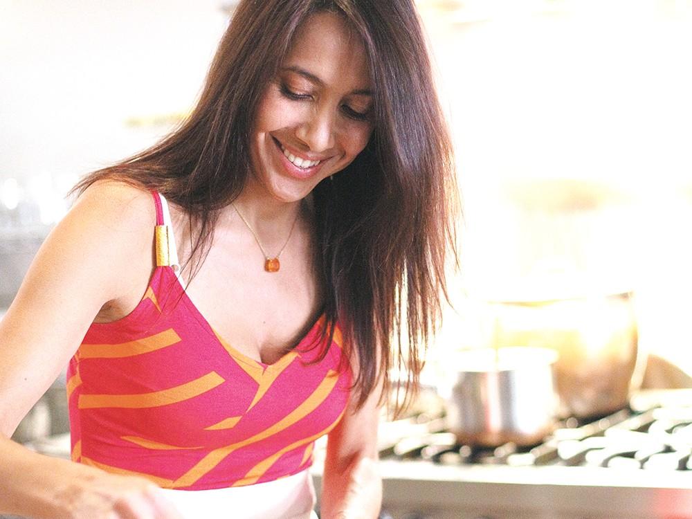Sara Balcazar-Greene works the wok in the kitchen located inside The Purple Turtle. - YOUNG KWAK