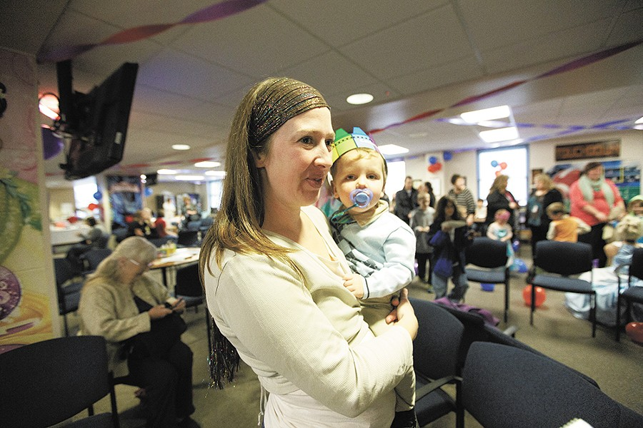 Sarah Jorgensen celebrates with her newly adopted son, Lørn, at the Spokane County Courthouse last week. - YOUNG KWAK