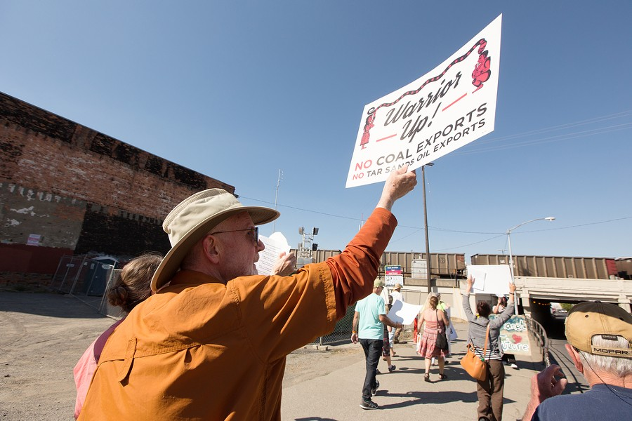 Scott Frost, left, walks north on S. Browne St. - YOUNG KWAK