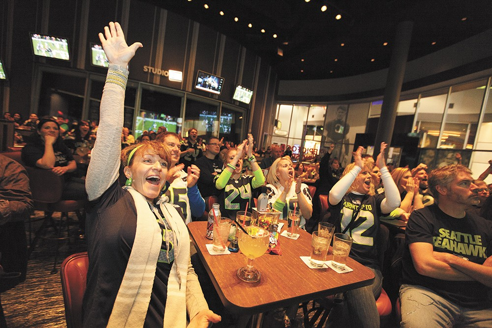 Seahawks fan Tammy Duenas celebrates the NFC Football Championship win against San Francisco at Northern Quest Resort & Casino's EPIC bar. - YOUNG KWAK
