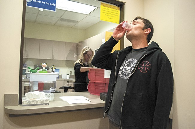 Sean downs his daily dose of methadone at the Spokane Regional Health District. - SARAH WURTZ