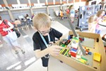 Second-grader William Holland demonstrates his windmill robot as part of the Jr. 1st Lego League competition.
