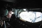 Senior Airman Dave Fernandez refuels an F-16 from a KC-135.