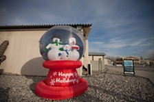 An oversized snow globe sits in front of the A'la Too dining facility at the Transit Center at Manas, Kyrgyzstan. - YOUNG KWAK