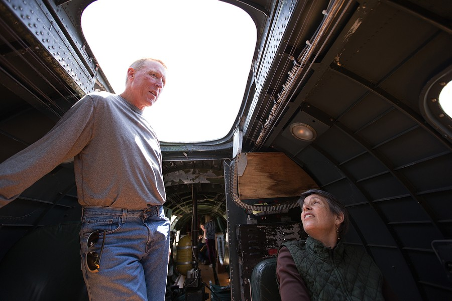 Siblings Patrick Wolf, left, and Janet Hara sit inside the plane. Their uncle Phillip Wolf served as a tail gunner in a B-17 during World War II in the U.S. Army Air Corps. - YOUNG KWAK