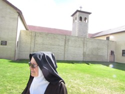 Sister Marie Joseph outside the stone walls of the Carmel of the Holy Trinity, near the now-closed Painted Hills golf course in Spokane Valley. - DANIEL WALTERS