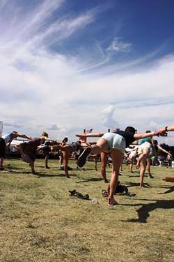 Sasquatch! 2015 festival goers getting into their best Warrior Three yoga position Saturday morning. - LAURA JOHNSON