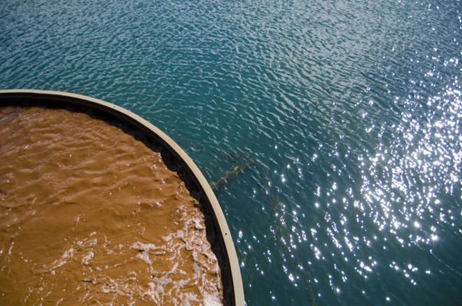 Sludge vs. treated water in clarifier tank. - JACOB JONES