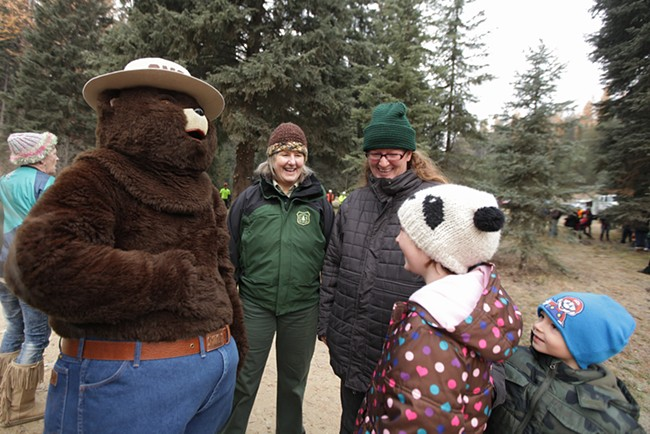 Smokey the Bear, left, hangs out with (left to right) U.S. Forest Service employee Gayne Sears, Chelsea Earls, her 8-year-old daughter Olivia and 5-year-old son Oliver. - YOUNG KWAK