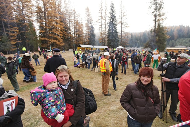 Sonia Wirth, left, holding her 20-month-old daughter Sadie, and Stephanie Wirth wait for the tree to be cut. - YOUNG KWAK