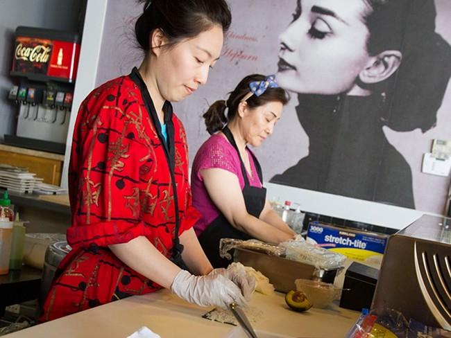SooJi Shin, left, and her mother, Sophia Lee, roll sushi at Kinja. - JENNIFER DEBARROS