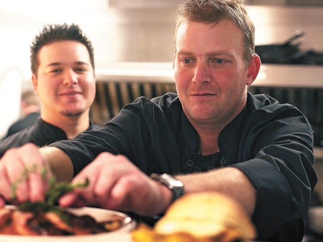 Sous-chef Justin Braviroff, left, looks on as co-owner Jason Rex garnishes the Muscovy duck at Fraiche. - YOUNG KWAK