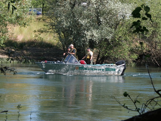 Spokane County sheriff's deputies search the Spokane River on Wednesday afternoon. - CHRIS BOVEY