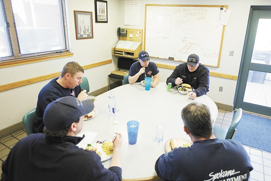 Spokane firefighters gather for a group lunch at Station No. 2. - YOUNG KWAK
