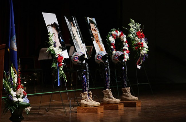 Memorials onstage to honor three fallen airmen. - YOUNG KWAK
