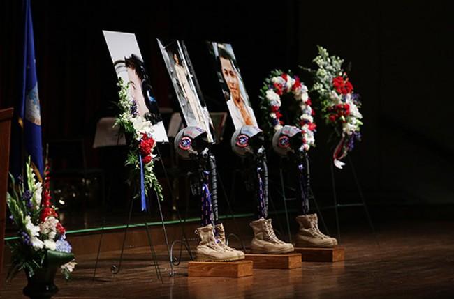 Memorials onstage to honor three fallen airmen. - YOUNG KWAK
