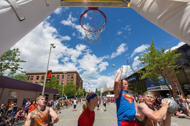 Spokane local Matt Miller, right, finds his way to the basket. - MATT WEIGAND
