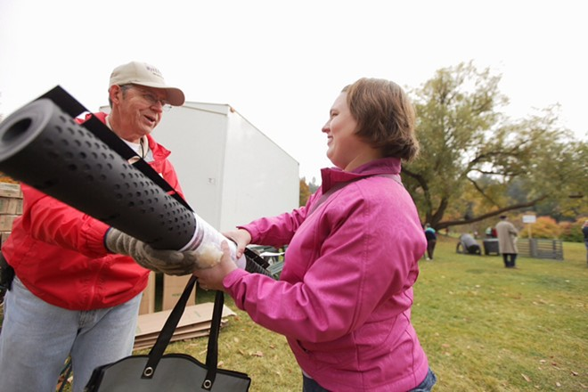 Spokane Master Composters volunteer Mike Rapp, left, hands a compost bin to Rebecca Woodbury. - YOUNG KWAK