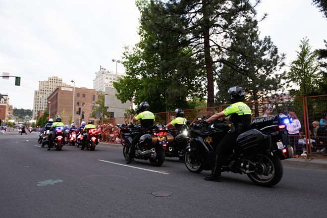 Spokane Police Department and Spokane County Sheriff's Office motorcycles prepare to start the parade. - YOUNG KWAK