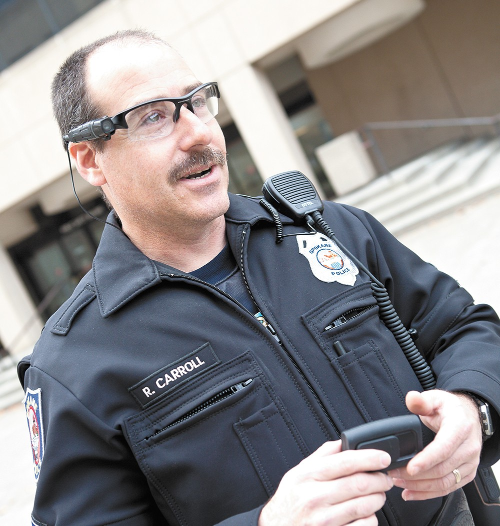 Spokane Police Officer Vic Carroll testing out body cameras. - STEVEN SCHLANGE