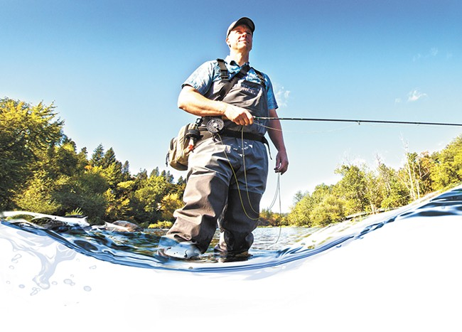 Spokane Riverkeeper Jerry White in the Spokane River in the Peaceful Valley neighborhood. - YOUNG KWAK
