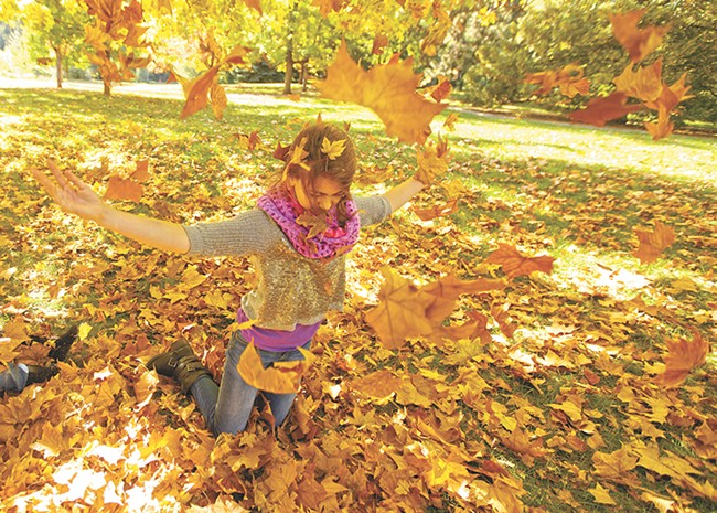 Spokane's John A. Finch Arboretum becomes a playground for Quinn, 10, and her younger siblings over the weekend. - YOUNG KWAK