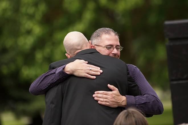 Former airman Stuart Heberlein, right, hugs and thanks Brown. - YOUNG KWAK