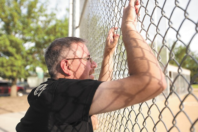 Stuart Heberlein watches his son try out for a baseball team at Chief Garry Park. Heberlein tried to resuscitate a doctor mortally wounded during the 1994 shooting. - YOUNG KWAK