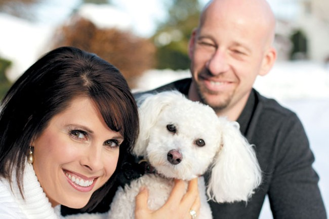 Susan Cerutti-Jensen today, with her husband Rick Jensen and her bichon frise Buster. - YOUNG KWAK