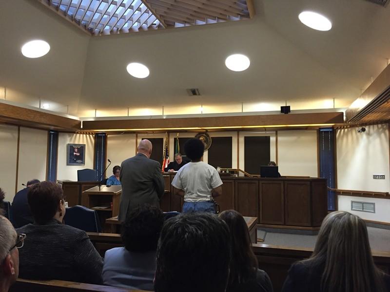 Kenan Adams-Kinard (right) and attorney Derek Reid - DEANNA PAN