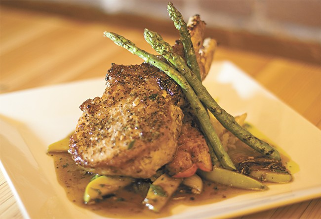 Tamarack Public House's double bone-in pork chop. - JOE KONEK