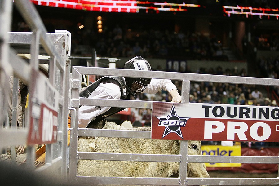 Tanner Burne, of Prince Albert, Saskatchewan, Canada, rides 919 Gotta Go, during Flight 3, on Saturday. He rode 2.34 seconds before falling off the bull. - YOUNG KWAK