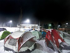 """Tent City,\"" as it\'s become known, is home to hundreds of Gonzaga students hoping to get close to the court for big games. - YOUNG KWAK"