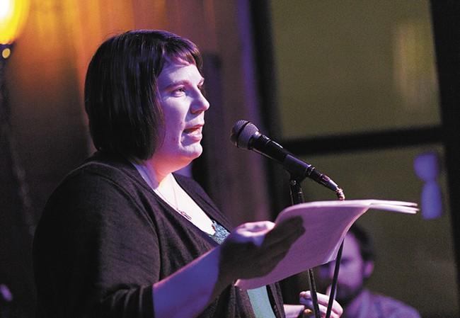 """Teri Koski reads her poem """"The Truce"""" at an open mic night. - YOUNG KWAK"""