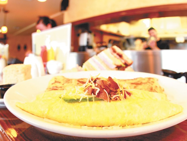 The bacon avacado omelet at Dolly's is just one of the breakfast options at the popular Spokane eatery. - JOE KONEK