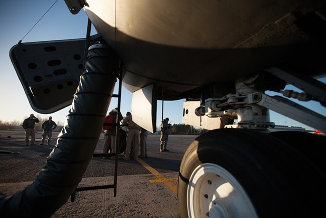 The crew of Shell 74, a 376th Expeditionary Operations Group refueling mission over Afghanistan speaks with a maintenance crew outside a KC-135. - YOUNG KWAK