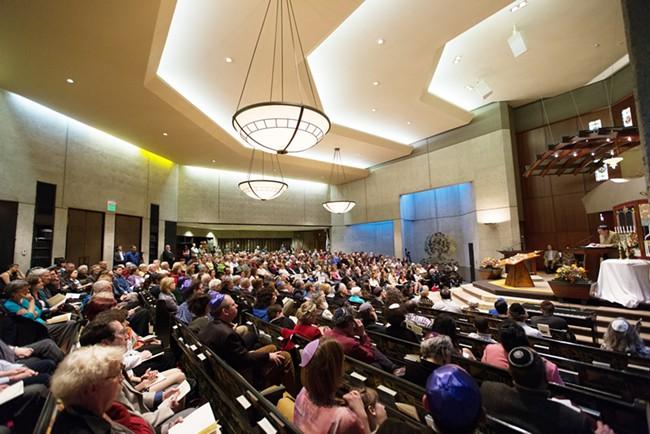 The crowd listens as Holocaust survivor Stephen Adler speaks. - YOUNG KWAK