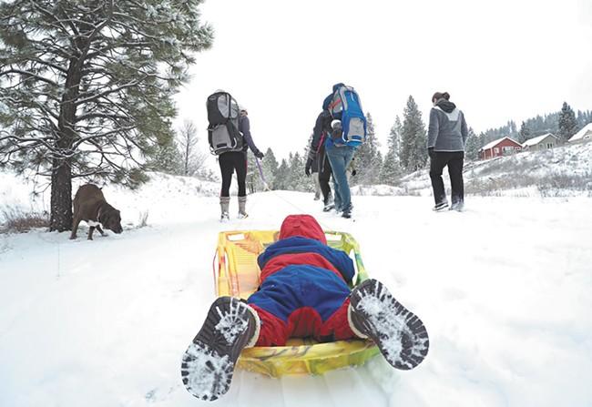 "The ""Hike It Baby"" group gathers for a snowy walk on Spokane's Fish Lake trail. - JOE KONEK"